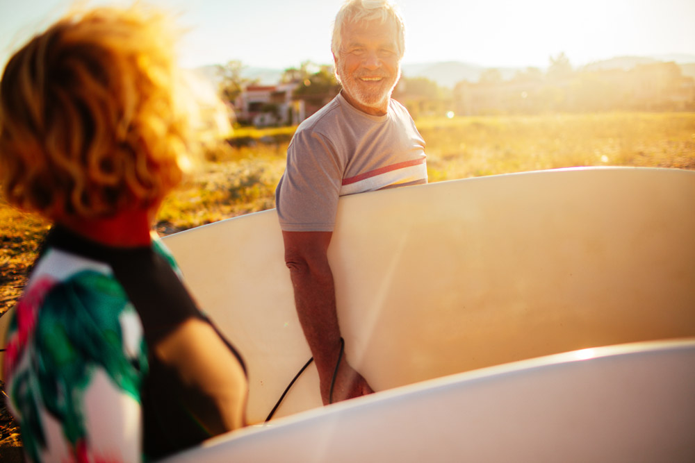 Senior couple going surfing
